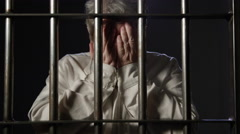 Justice System - Inmates in Prison Behind Bars - elderly woman Stock Footage