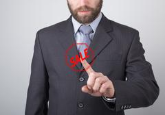 Technology, internet and networking concept - Businessman presses sale button on Stock Photos