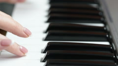 Hands of a young woman playing piano Stock Footage