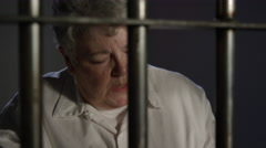 Justice System - Inmates in Prison Behind Bars - woman counting cash Stock Footage