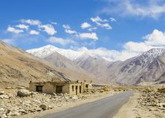 Road on plains in Himalayas - stock photo