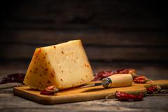 Aging artisan cheese - stock photo