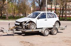 Transportation emergency sport car on the trailer - stock photo