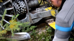 Man replaces the chain at Forest Harvester. Stock Footage