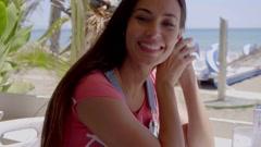 Adorable young woman near tropical beach Stock Footage