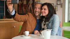 Mature couple taking selfie picture Stock Footage
