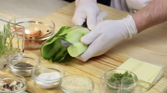 Cook prepares canapes in the kitchen at the restaurant Stock Footage