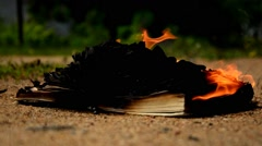 Book burning on the ground. Stock Footage
