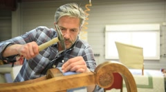 Man working in upholstery workshop Stock Footage