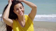 Happy vivacious young woman enjoying nature Stock Footage