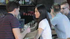 Young people talking at the bar Stock Footage