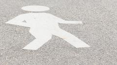Pedestrian pictogram on asphalt Stock Photos