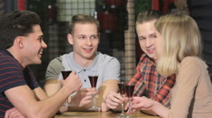 Four young people drink liquor at the bar Stock Footage