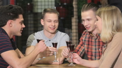 Group of young people drinks off liquor at the restaurant Stock Footage