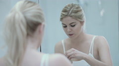 Pretty Young caucasian female applying make up in bathroom Stock Footage