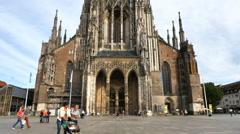 Ulm Minster church plaza pedestrians Ulm Germany Stock Footage