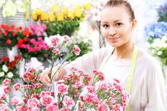 Beautiful cut flowers, florist arranges medley Stock Photos