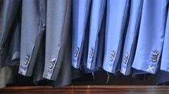 Man suit jackets in a suit shop Stock Footage