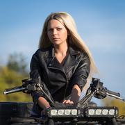 Elegant woman riding extreme quadrocycle ATV Stock Photos