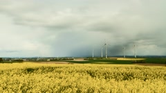 Timelapse - Canola fields and wind turbines Stock Footage