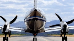 A turboprop plane taking off Stock Footage
