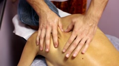 Back massage by hands on woman - stock footage