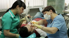 Treatment of caries. Man visits the dentist. - stock footage