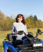 Elegant woman riding extreme quadrocycle ATV Stock Photos