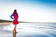Woman in red have fun on the cost of the lake - stock photo