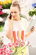 Flower accepts telephone order for a bouquet - stock photo
