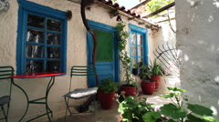 traditional greek house court relax area dolly camera - stock footage