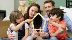 A smiling family of four settling in a new place - stock footage