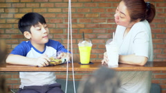 Happy asian mom with her son eating snack and playing together make fun Stock Footage