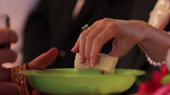 Bride takes a piece of bread from the priest and bite it Stock Footage