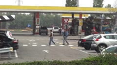 Cars and people can see through the window of the bus parked in a fuel station Stock Footage