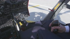 View at pilot hold control handle and take off on helicopter. Camera inside Stock Footage