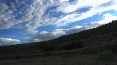 Countryside in Spain saw the bus window with fluffy clouds covering the sky blue Stock Footage