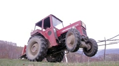 Drivers who pick up his tractor to the rear wheels, the front ones remaining - stock footage