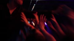 Hands stretched to the lead singer who has performed and shared disks that fans Stock Footage