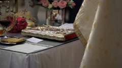 On the table in front of of the priest is holy book, diadems grooms and traditio Stock Footage