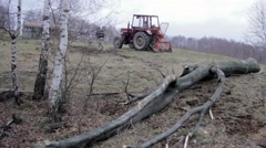 Tractor pulling a large trunk in the thick forest Stock Footage