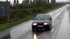 Oncoming cars are seen through the windscreen of a bus full of splash - stock footage