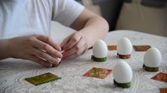 Boy sticks stickers on  Easter eggs Stock Footage