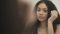 Pretty Young Afro American female applying make up in bathroom - stock footage