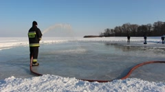 Firefighters are making ice rink on the frozen Vistula Lagoon for the residen Stock Footage