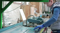 Woman working with factory machines at the window factory. 4K Stock Footage