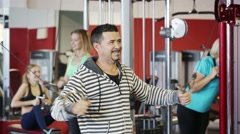 Adults of different age having strength training in gym - stock footage