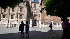 Seville cathedral with girls watching Stock Footage