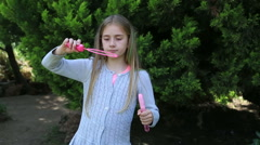 Cute girl  blowing bubbles - stock footage