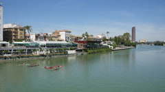 Seville Guadalquivir River with rowing shells Stock Footage
